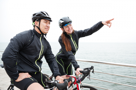 happy-woman-cyclist-showing-finger-on-something-P8W22EX